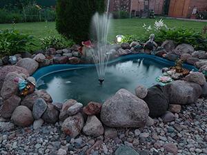 Украшение участка фонтаном